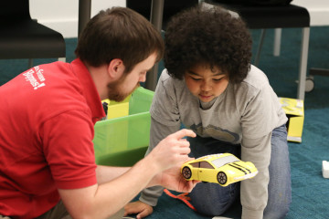 A child learns coding skills while playing with a ProBot.